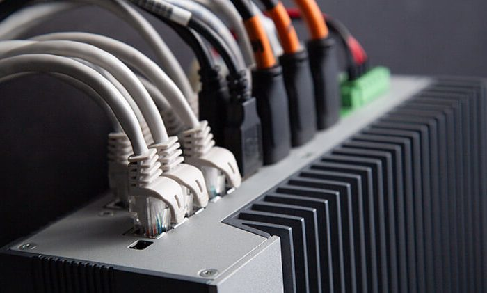 Industrial computer showing many I/O ports and cables